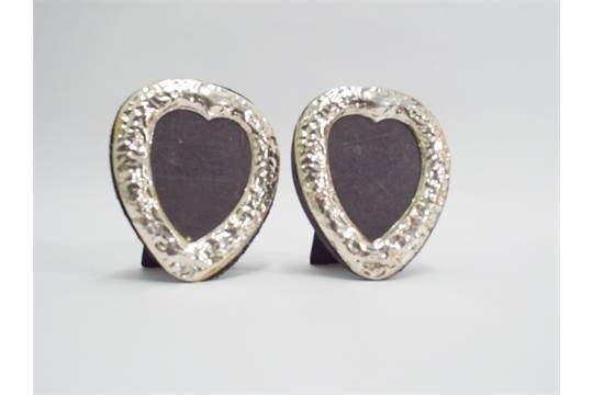 Pair of small silver heart shaped frames stamped 925 - 9cm tall