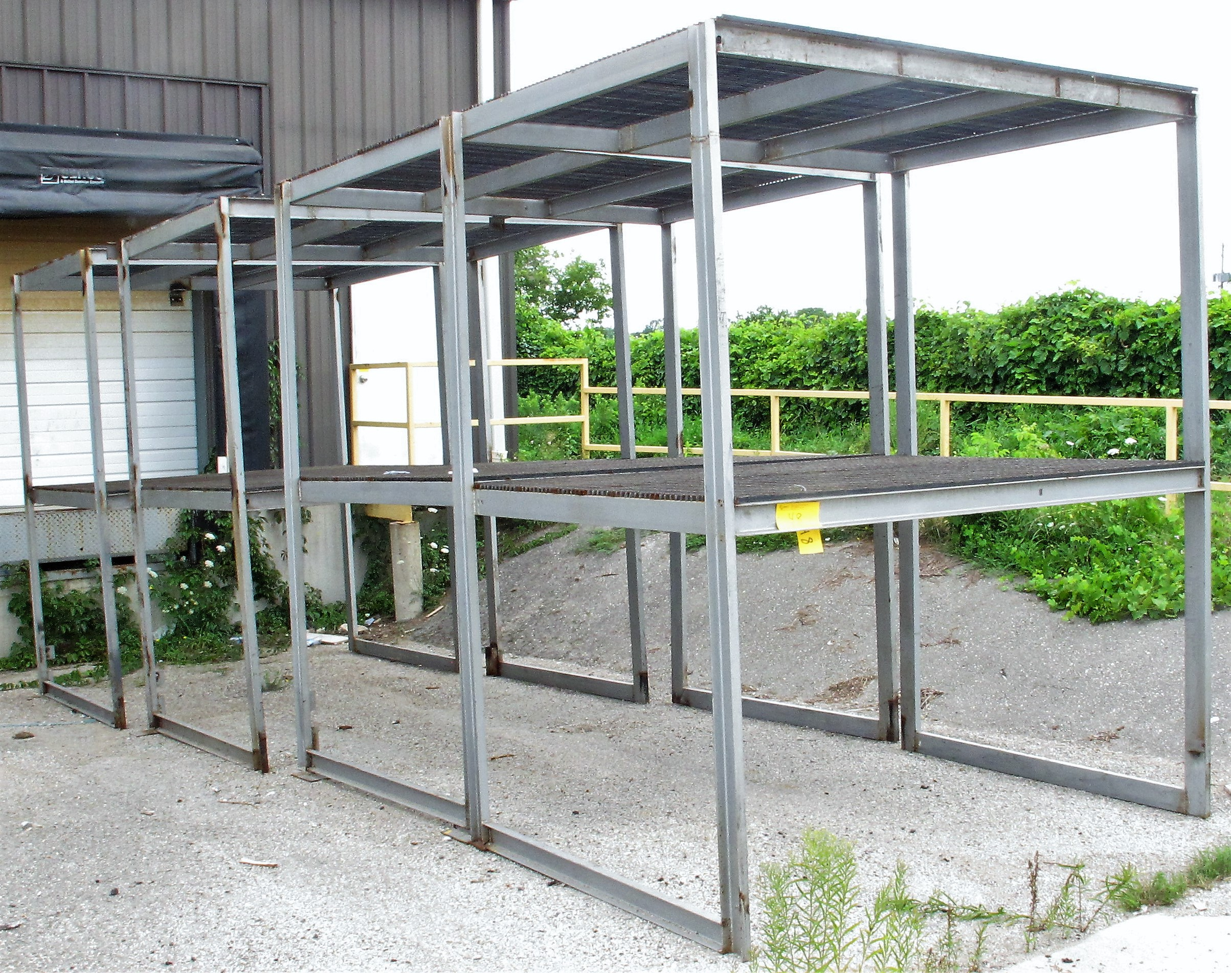 Lot 48 - LOT OF (4) 2-TIERED METAL RACKS (OUTSIDE)