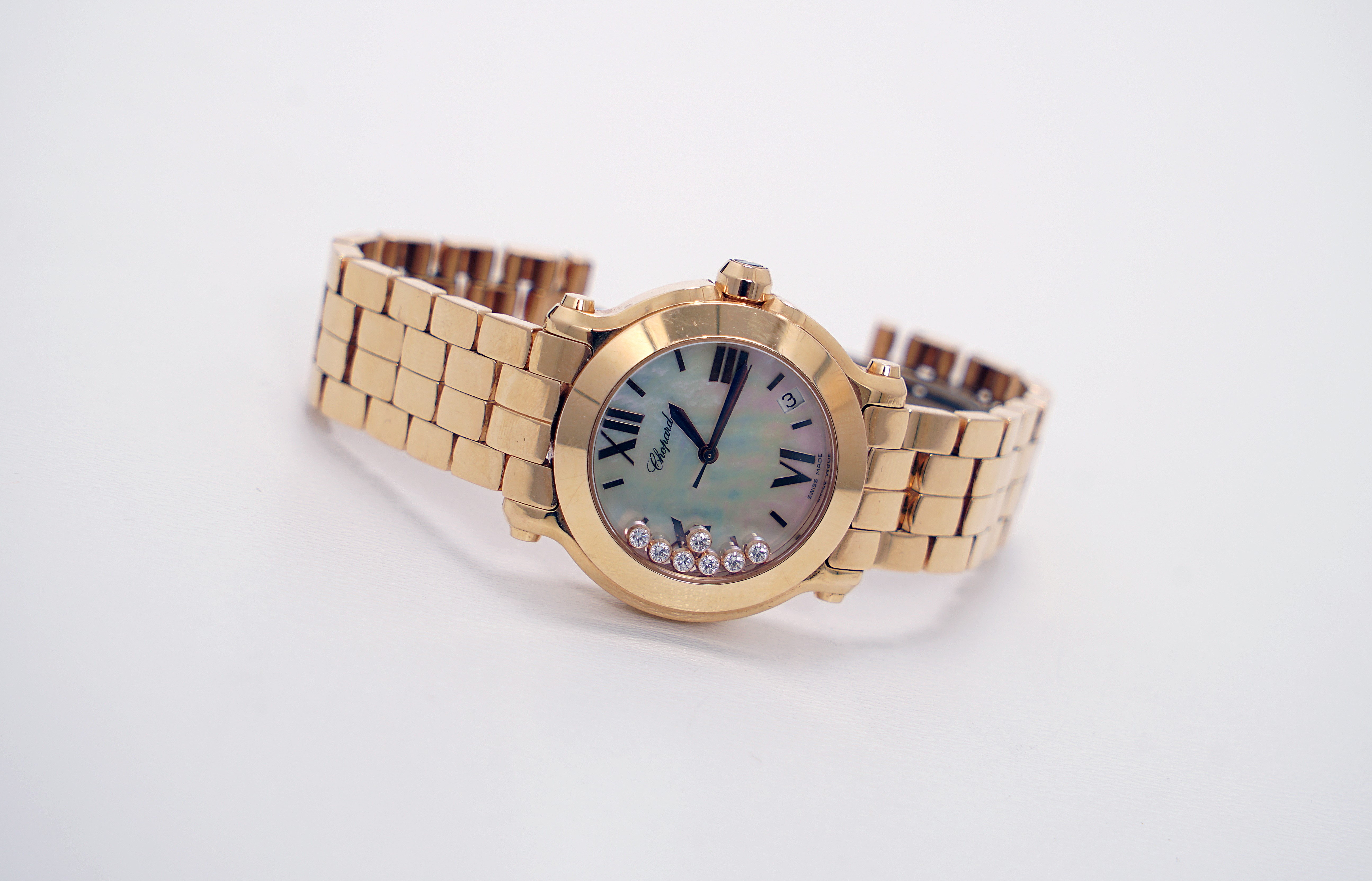 A Lady's 18K Rotgold Chopard Happy Sport Wristwatch with 1 Sapphire and 7 Diamonds - Image 2 of 10