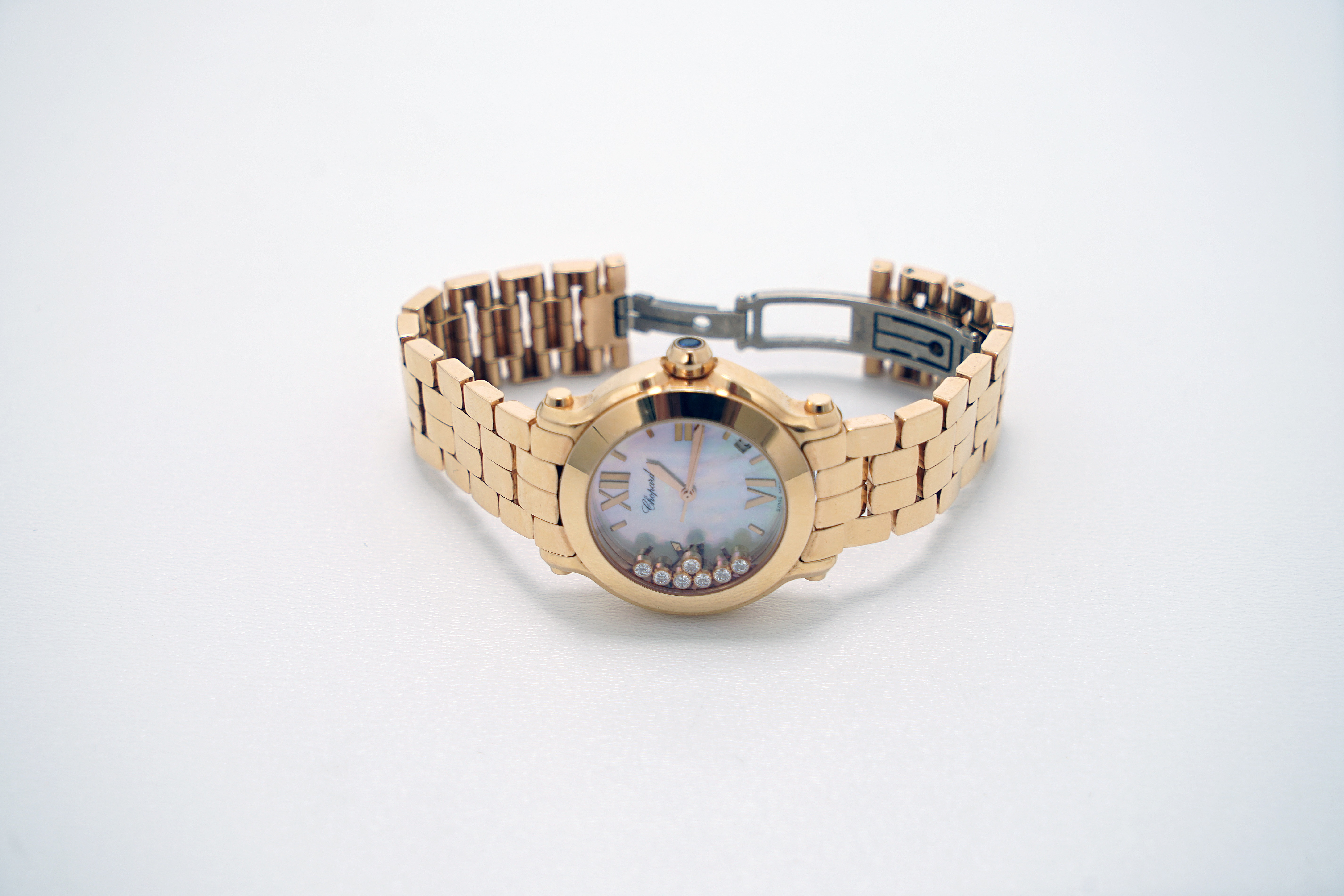 A Lady's 18K Rotgold Chopard Happy Sport Wristwatch with 1 Sapphire and 7 Diamonds - Image 7 of 10