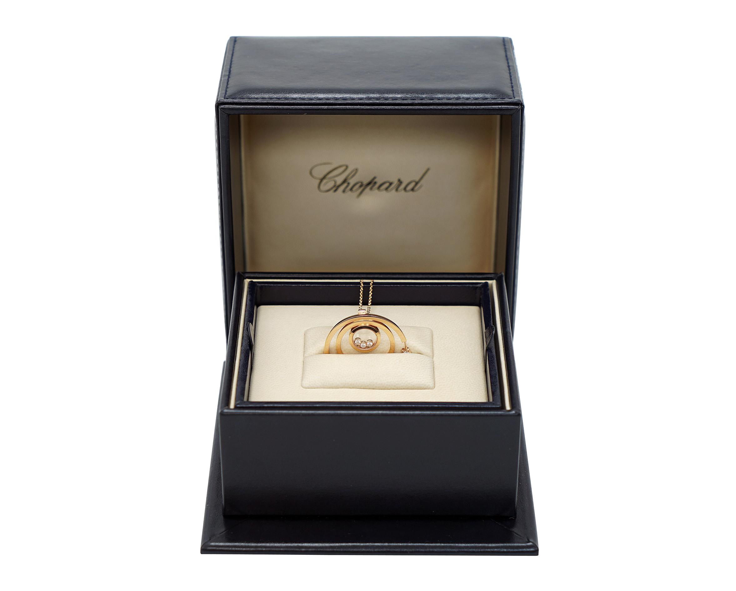 A Lady's Chopard 18K Rose Gold , Happy Diamonds pendant