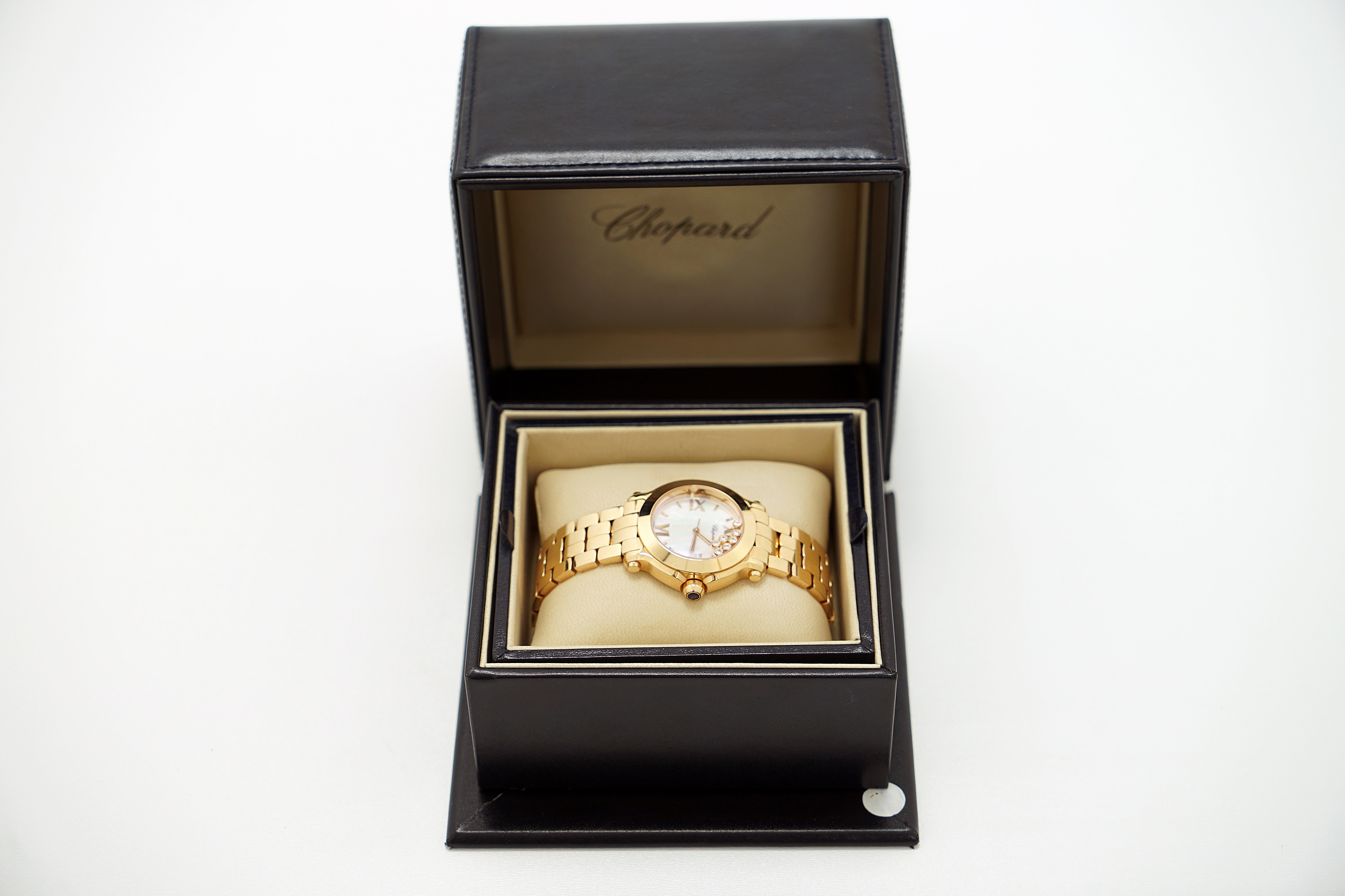 A Lady's 18K Rotgold Chopard Happy Sport Wristwatch with 1 Sapphire and 7 Diamonds - Image 6 of 10