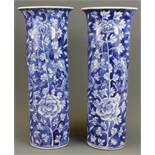 A pair of 19th Century Chinese hand painted porcelain cylinder vases, H. 31cm. With restoration to r