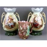A Majolica leaf jug and a pair of Victorian vases, vase H. 37cm.