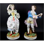 A pair of large 19th Century French hand painted bisque porcelain figurines, H. 39cm.