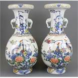 A pair of early - mid 20th Century Chinese hand painted porcelain vases with elephant head