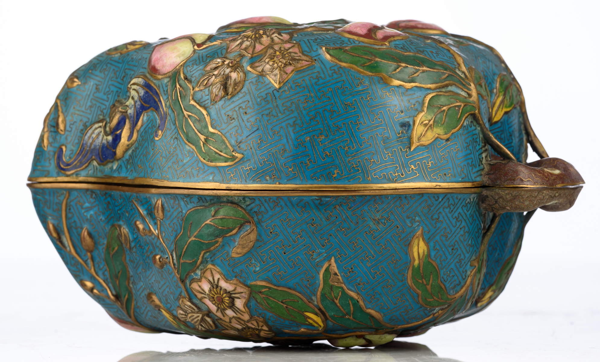 Lot 4 - A Chinese peach shaped cloisonné box and cover, the outside with the symbolic nine peaches relief