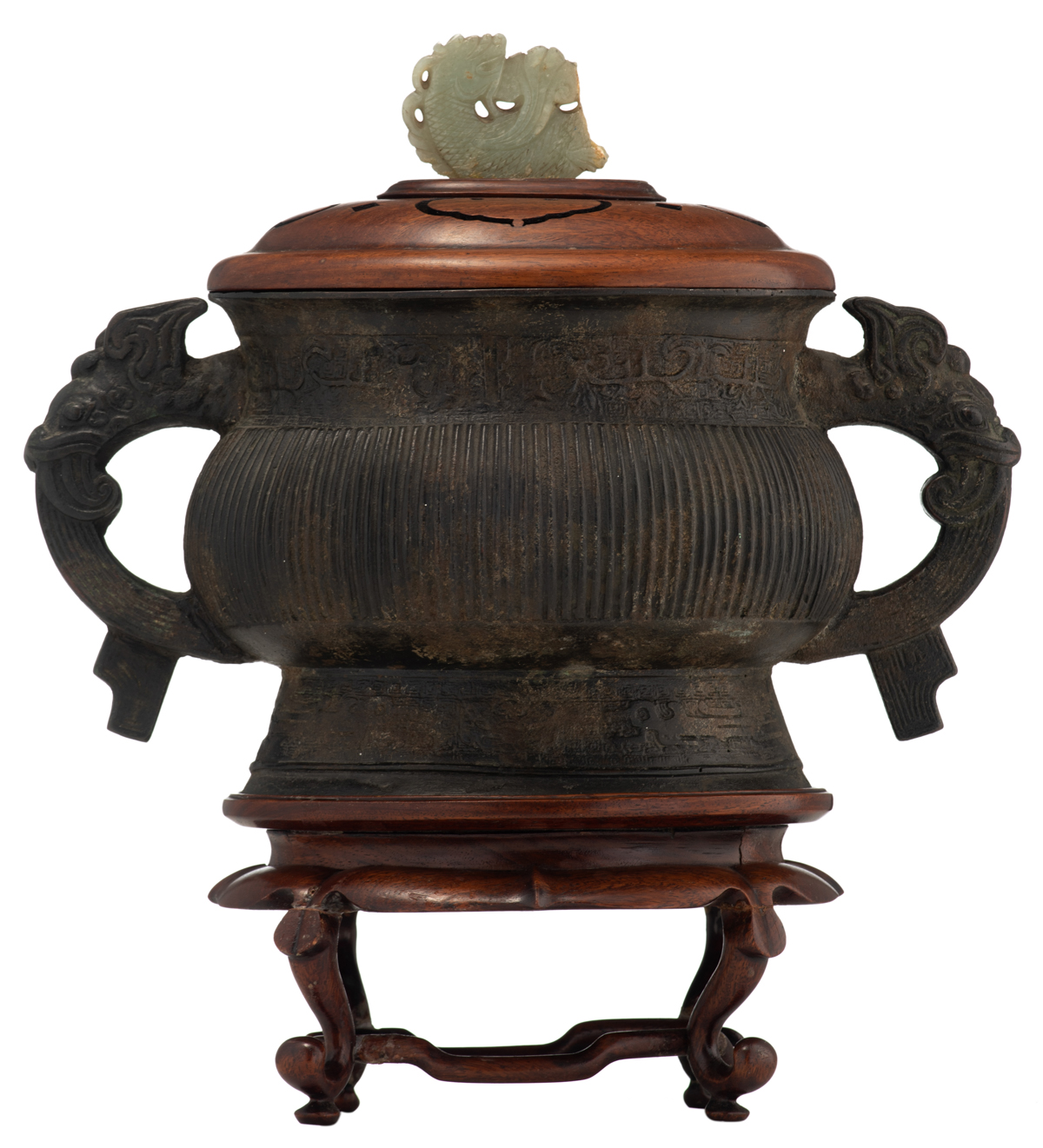 Lot 9 - A Chinese archaic Zhou type bronze gui vessel, the handles dragon shaped, the exotic hardwood