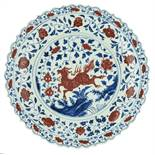 An imposing Chinese cobalt blue and copper red Ming type charger, decorated with floral motifs and a