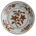 A Chinese copper red plate, decorated with lotus flowers, pomegranates, peaches, and persimmons,