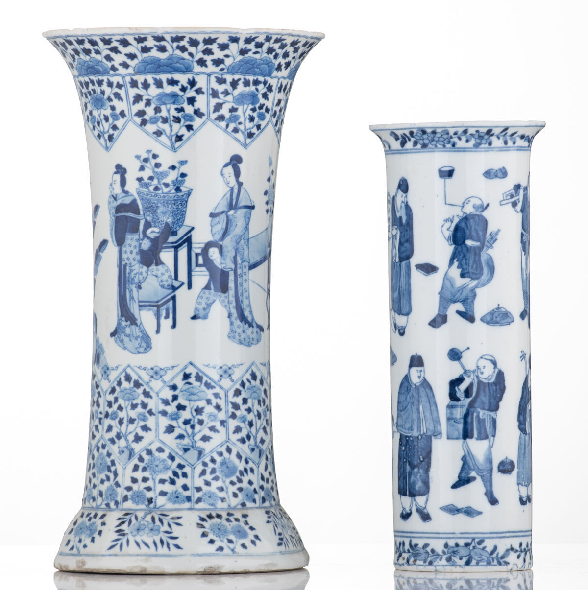 Lot 53 - Two Chinese blue and white gu shaped vases, one decorated with an everyday market scene, with a