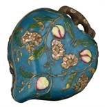 A Chinese peach shaped cloisonné box and cover, the outside with the symbolic nine peaches relief