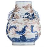 A Chinese cobalt blue and copper red hu vase, overall decorated with dragons among clouds, with a