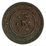 A Chinese silver plated bronze circular mirror, decorated with animals amidst fruiting grapevine,