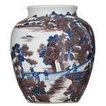 A blue and white and copper red jar in the Ming style decorated with travellers in a mountainous