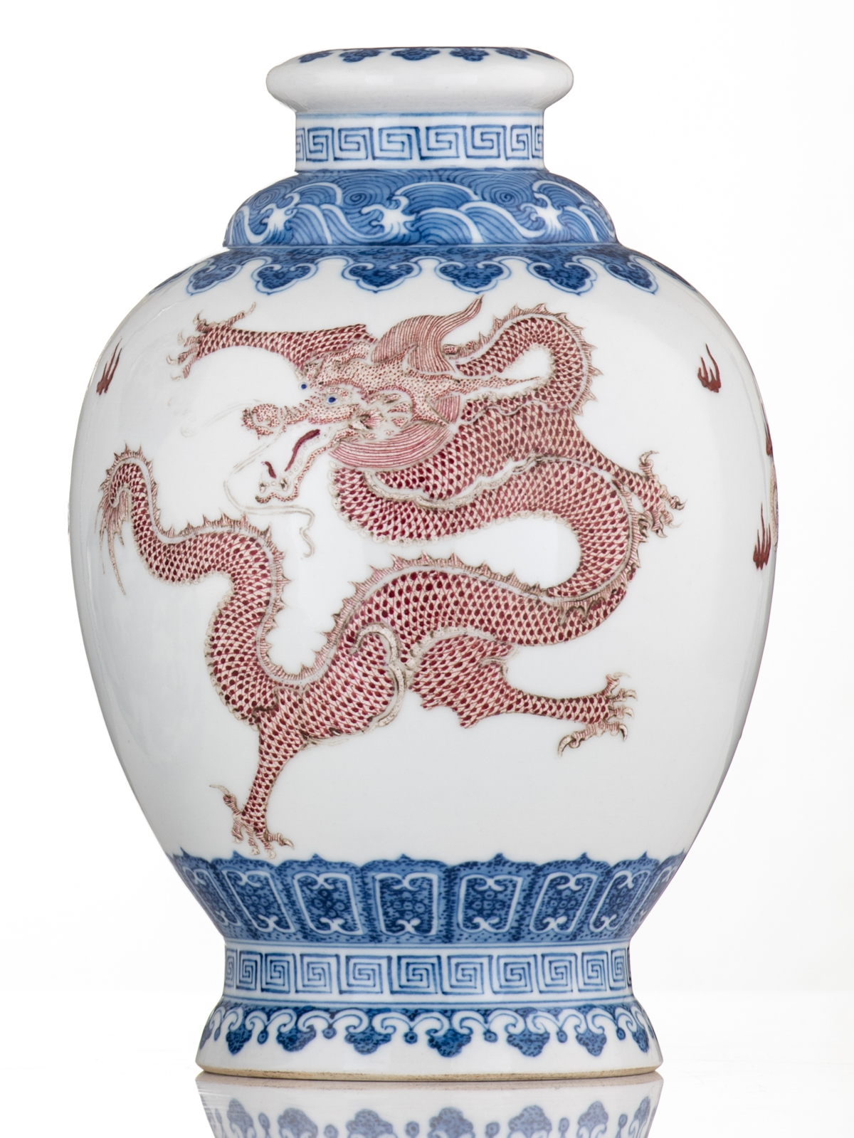 Lot 47 - A Chinese blue and copper red decorated vase, the five clawed dragons chasing the flaming pearl