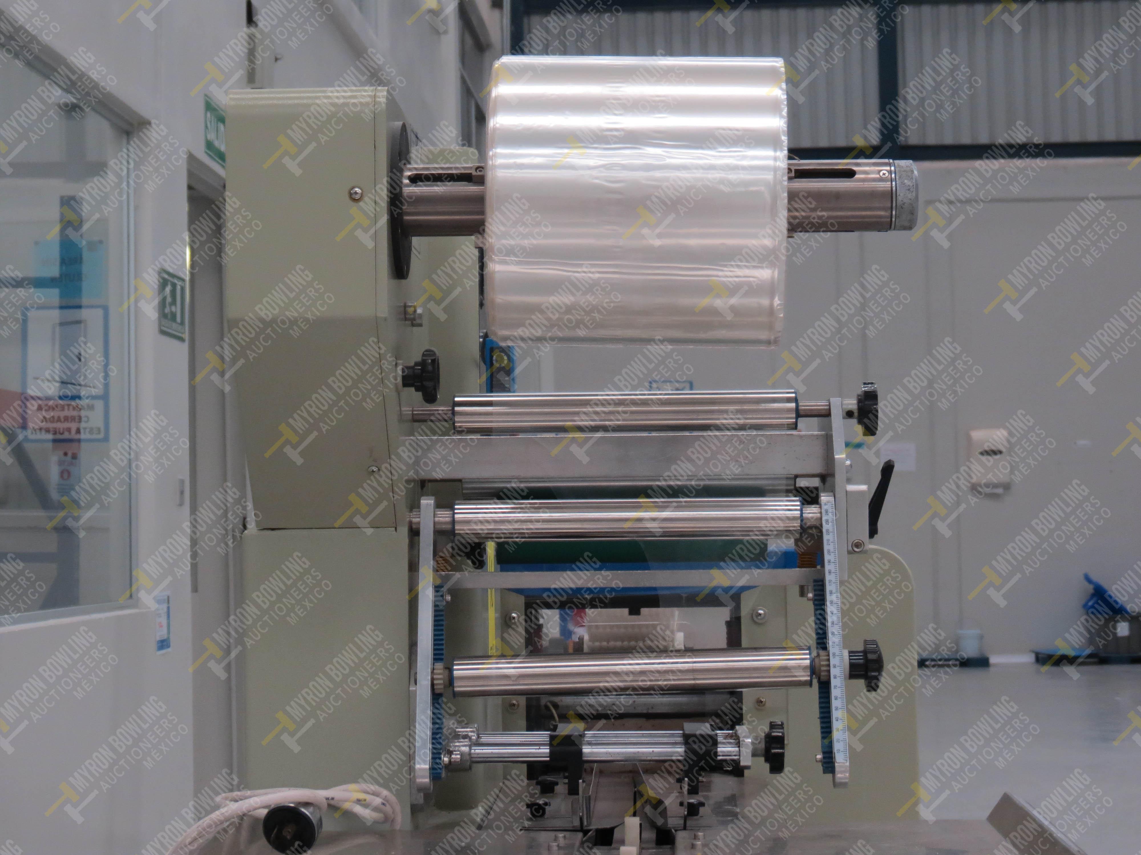 Máquina empacadora automática tipo almohadilla marca Shandong Saixin Inflating Machinery … - Image 5 of 9