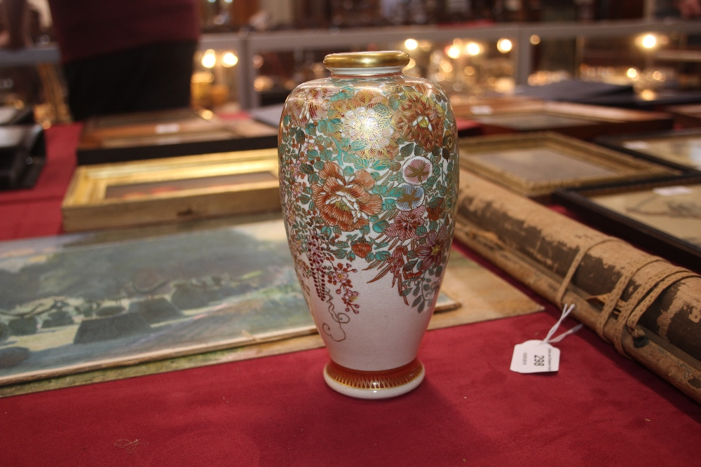 Lot 3 - A Japanese Satsuma baluster vase, having profuse floral decoration heightened in gilt, signature