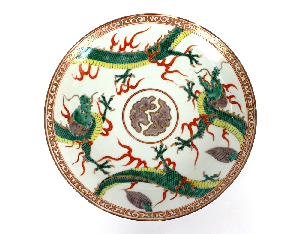 Lot 1 - A 19th Century Chinese shallow dish, decorated with dragons and clouds, heightened in gilt, 31cm