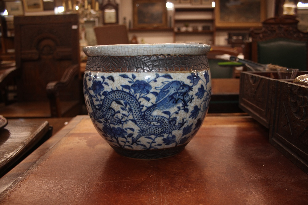 Lot 5 - A 19th Century Chinese crackle glaze baluster jardiniére, having continuous dragon and foliage