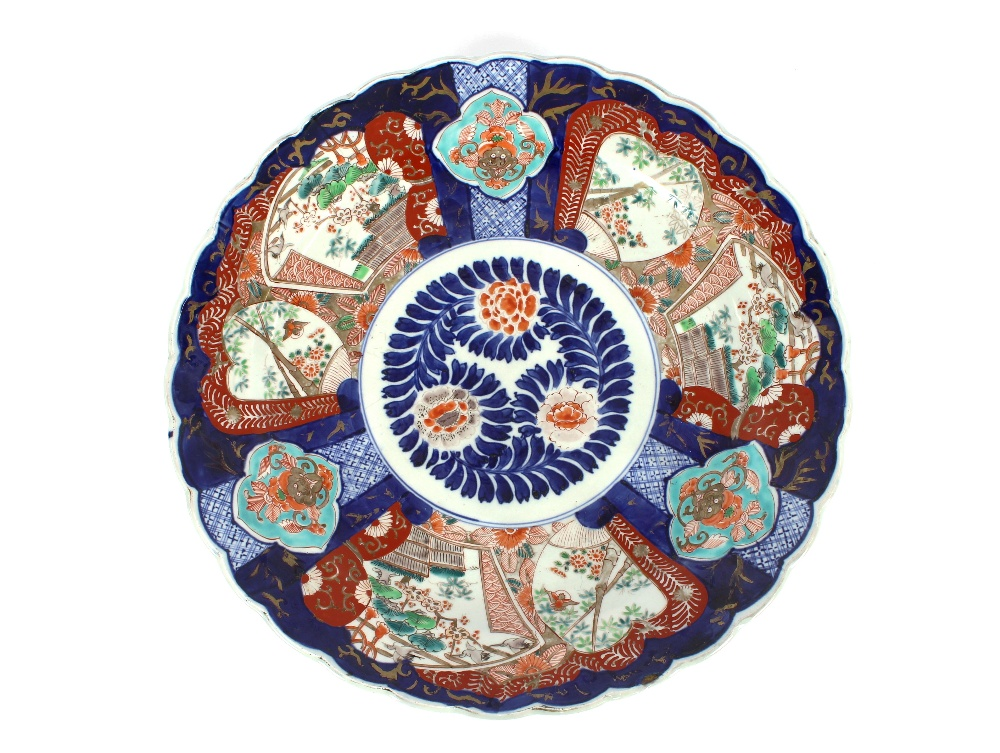 Lot 36 - A pair of 19th Century Japanese Imari chargers, having scallop borders, panels decorated with