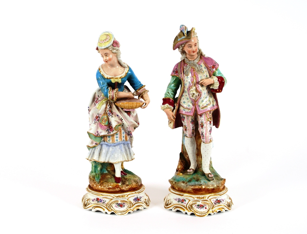 Lot 23 - A pair of late 19th Century Meissen style figures, depicting maid and youth, raised on floral