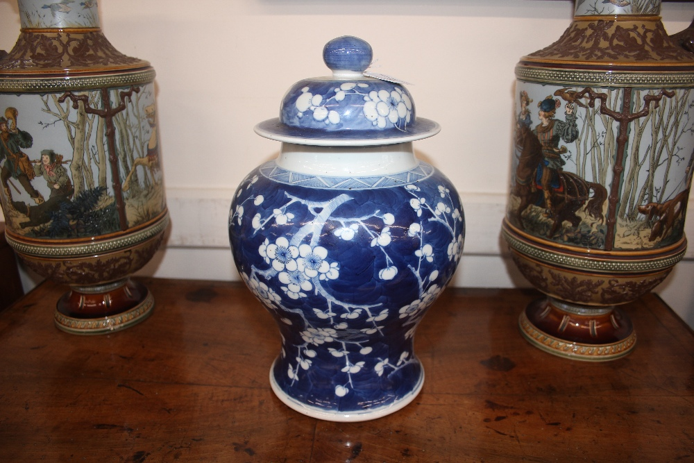Lot 26 - A 19th Century Chinese blue and white baluster vase and cover, with Hawthorn decoration, six