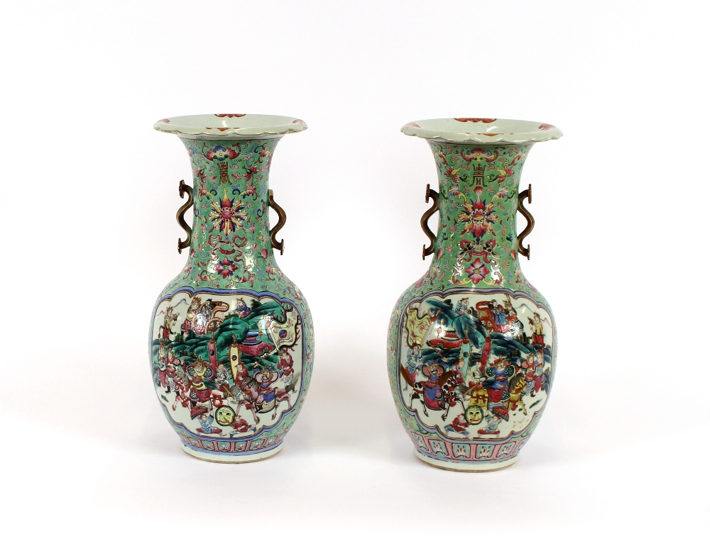 Lot 35 - A pair of 19th Century Chinese Canton baluster vases, having enamelled decoration depicting warriors