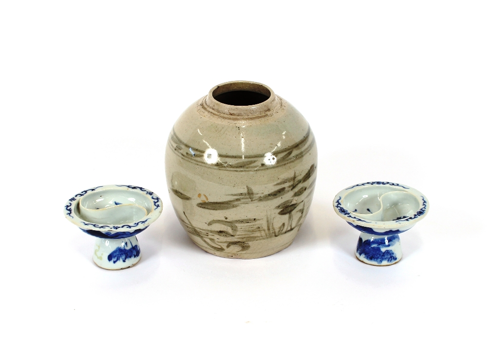 Lot 18 - A pair of Chinese blue and white porcelain salts, decorated with bats, river scenes and prunus,