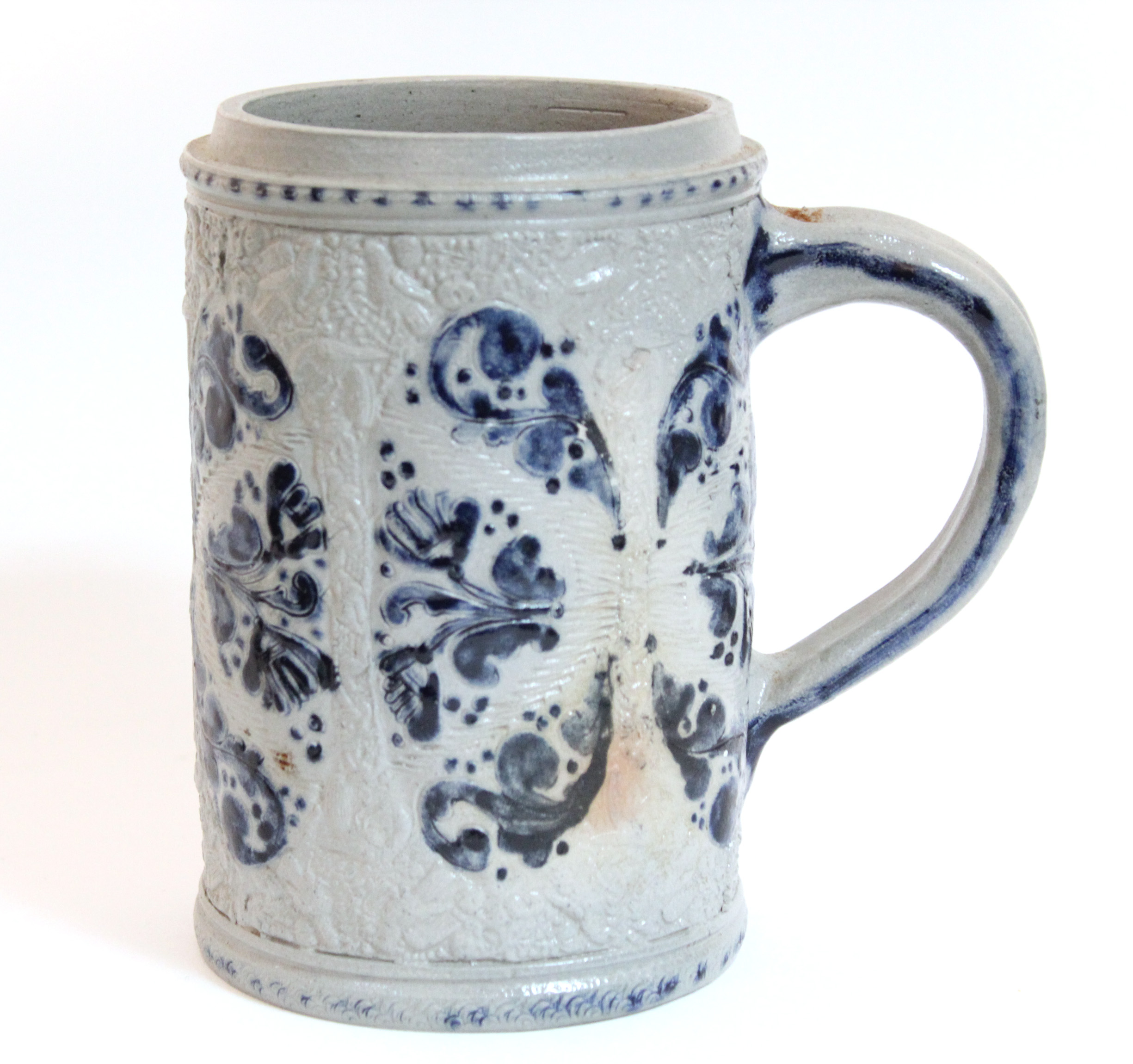 """Lot 77 - A German stoneware Westerwald-type cylindrical tankard, with relief decoration; 6½"""" high."""