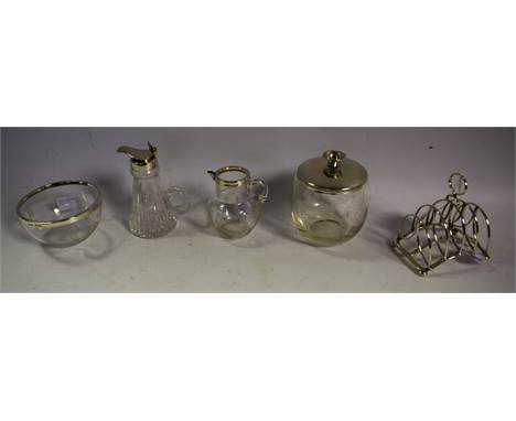 A silver mounted whisky noggin, Birmingham 2000; a silver mounted cream and sugar bowl, Birmingham 1903; a silver toast rack,