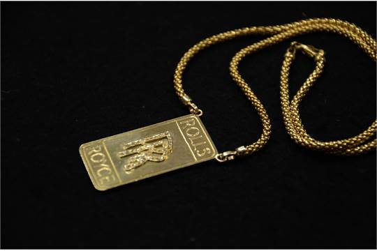 The piece features a rectangular pendant in solid 18 k gold with a previous aloadofball Gallery