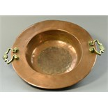 A copper dish with brass side handles, diameter 48cm.  CONDITION REPORT: Appears good with no