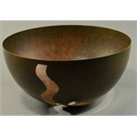 ALEX BROGDEN (born 1954); a large pierced copper bowl, diameter 42cm.   CONDITION REPORT: