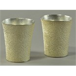 HIROSHI SUZUKI (born 1961); a pair of hallmarked 999 grade fine silver beakers, hammer raised,
