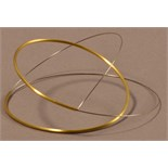 MARLENE McKIBBIN (born 1953); a rocking bangle of spiral form, gold and steel, inner diameter