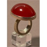 ROBERT FEATHER (born 1951); a hallmarked silver ring with large amber stone, ring size R.