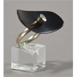 LESLEY STRICKLAND (born 1955); a hallmarked silver ring of large black resin dished oval form,