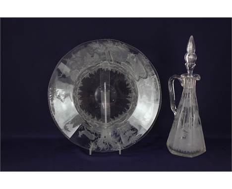 A Lobmeyr style glass dish, probably Austrian, engraved with stags amongst woodland, 34cm diameter, together with a similar g