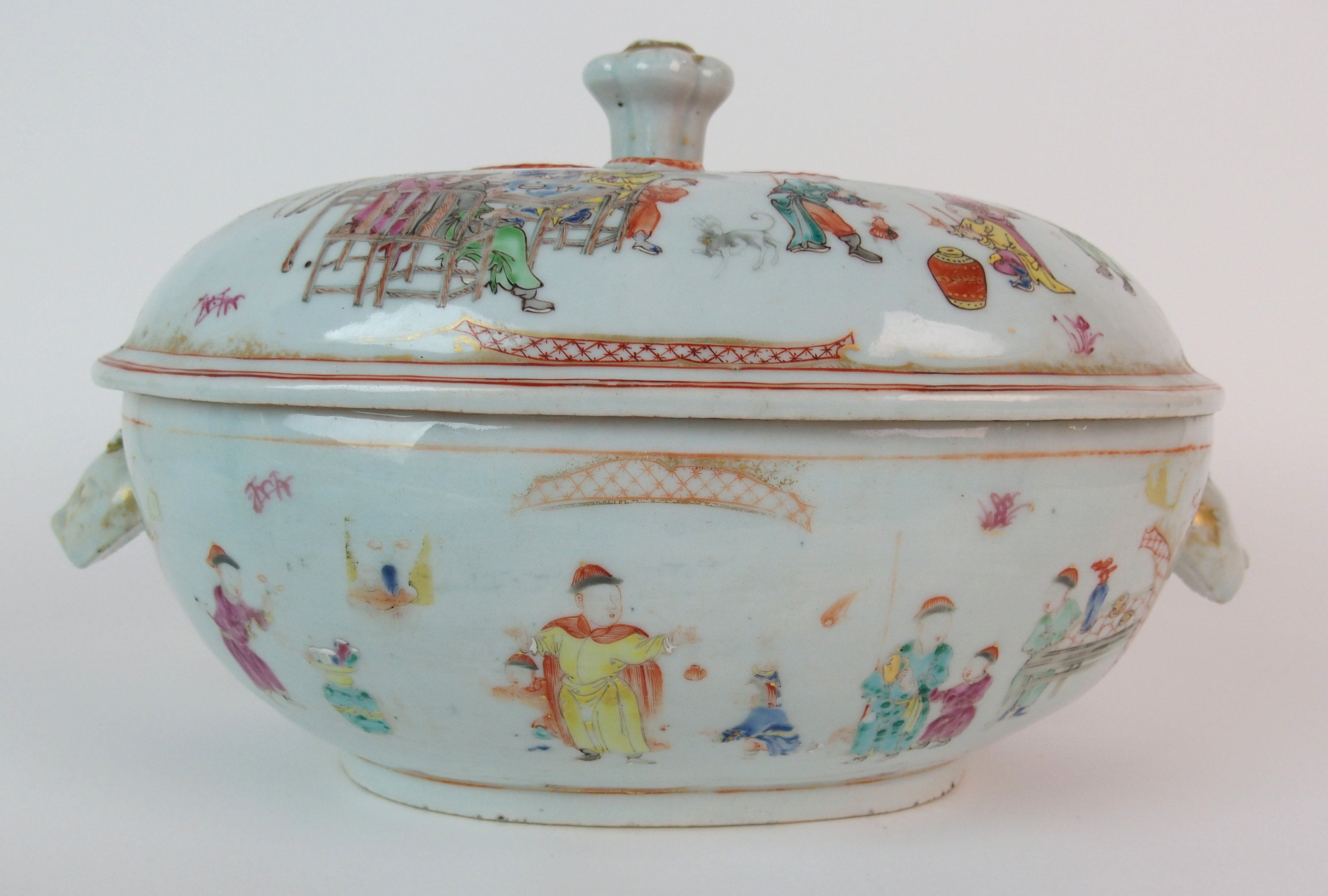 A Chinese export oval soup tureen, cover and stand painted with numerous figures beside tables, p