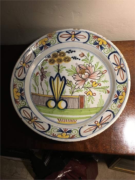 Lot 6 - Polychrome 18th c delft charger 34 cms diam.