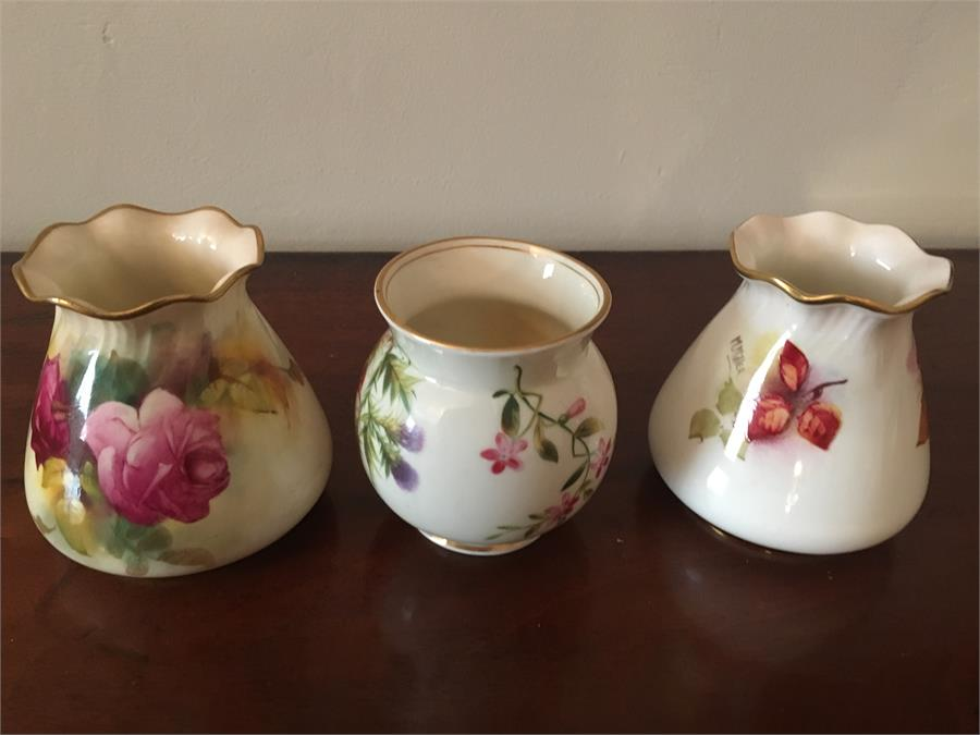 Lot 50 - Three small Royal Worcester small vases one by M Miller 8.5 cm high