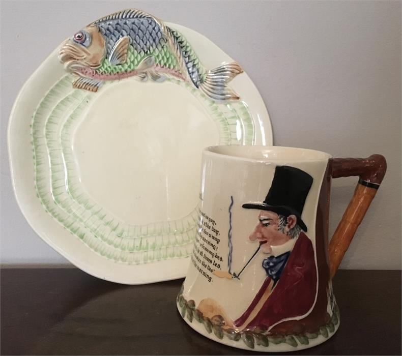 Lot 1 - Clarice Cliff moulded plate with fish decoration and a Crown Devon musical jug