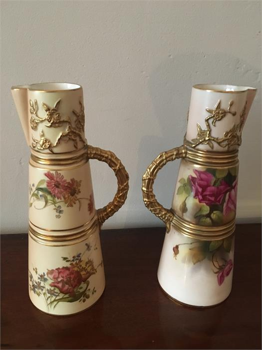 Lot 49 - Two Royal Worcester flower painted jugs 20 cm high