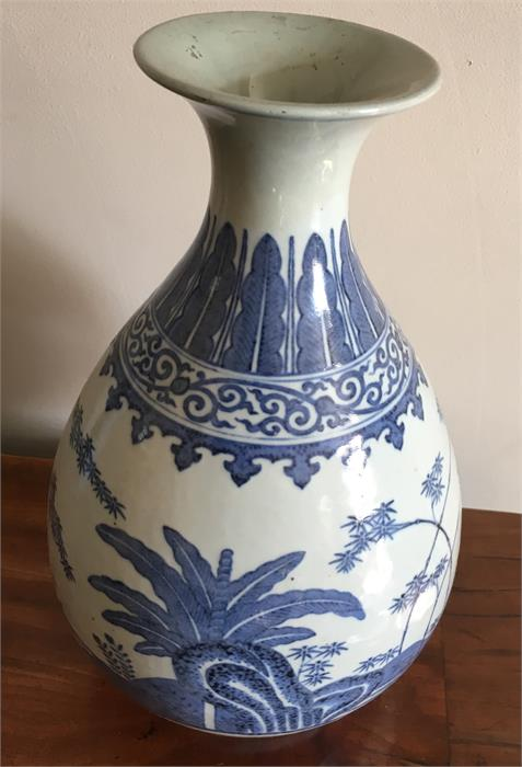 Lot 57 - A Chinese Ming style blue and white vase Guangxu mark and period (1875-1908) neck restored
