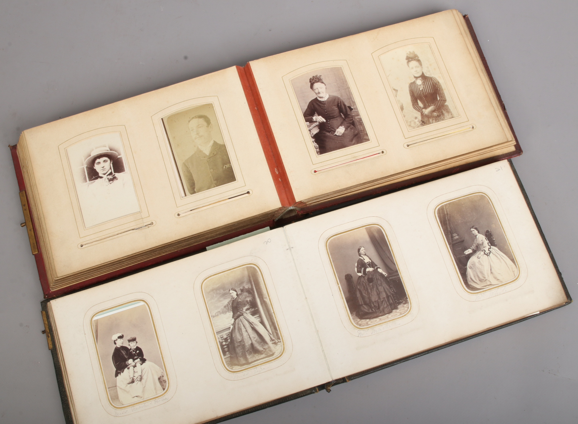 Lot 75 - Two Victorian photograph albums and contents of vintage monochrome photos.