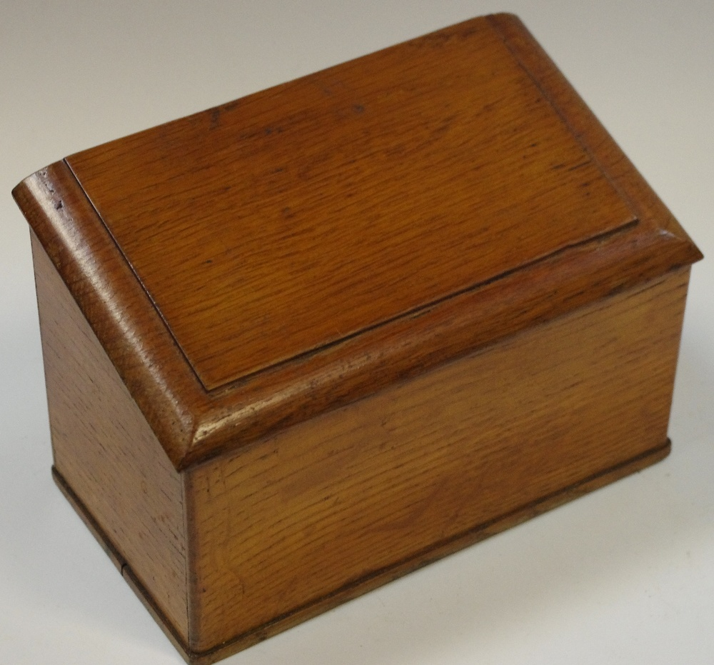 Lot 11 - A late Victorian oak slope top stationery box,