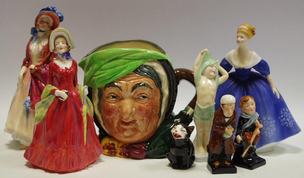 Lot 23 - A Royal Doulton figure, Paisley Shawl HM1984; Sabbath Moon HN1982; To Bed HN1805,