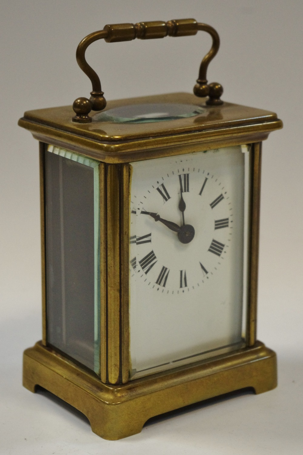 Lot 3 - An early 20th century lacquered brass carriage clock