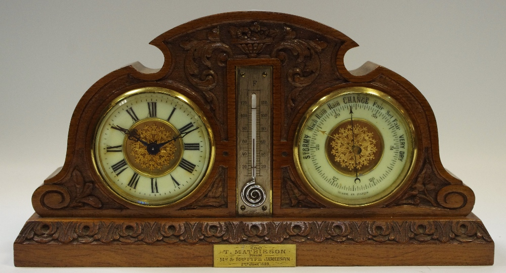 Lot 4 - A late Victorian oak combination clock, barometer and thermometer, c.
